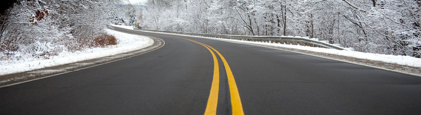 Snowy winter season with curvy road
