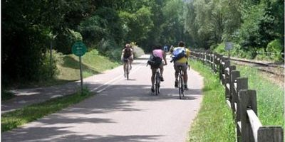 Three riders on a bike trail.