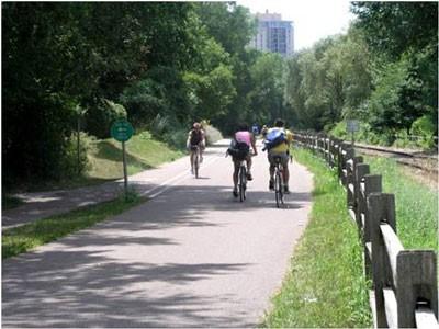 Three riders on a bike trail.