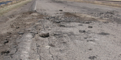 Photo of worn paved road